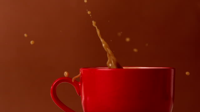 sugar cube falling into mug of tea - mug stock videos and b-roll footage