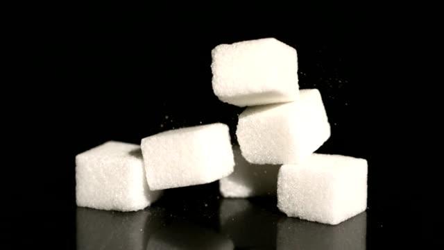 sugar cube falling on black surface - sugar cube stock videos & royalty-free footage