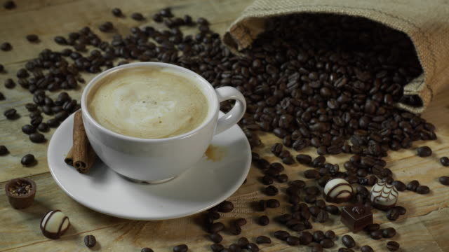sugar cube splashing in cafe latte coffee - sugar cube stock videos & royalty-free footage