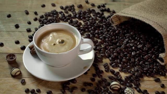 sugar cube splashing in hot coffee latte - sugar cube stock videos & royalty-free footage