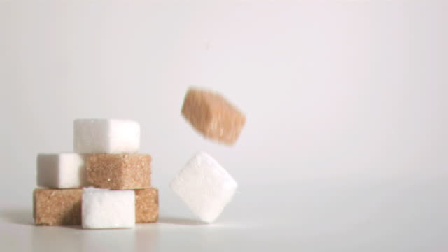 sugar cubes falling down in super slow motion - cube stock videos & royalty-free footage