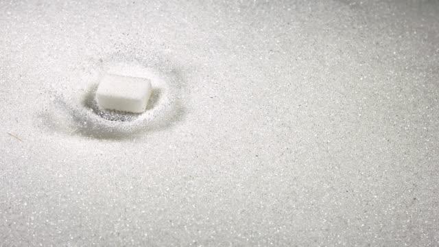 """sugar cubes falling, slow motion"" - sugar cube stock videos & royalty-free footage"