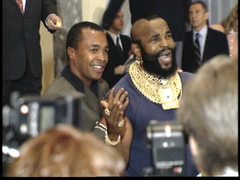 sugar ray leonard and mr t pose for paparazzi on red carpet - friars roast 1993 stock videos and b-roll footage