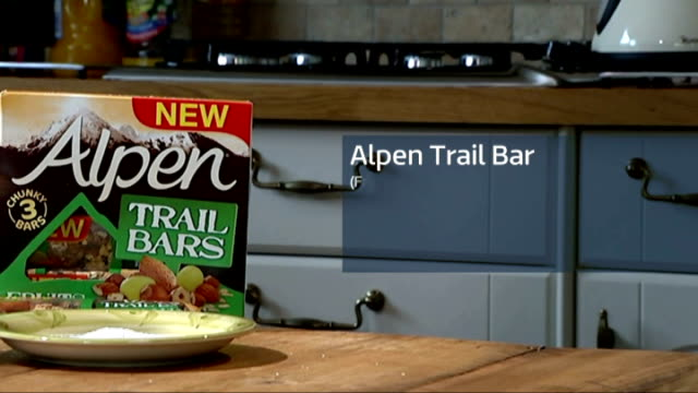 Sugar survey supports labelling on food and drinks Sugar poured into bowl and reporter to camera Alpen Trail Bar with graphics overlaid Nestle Munch...