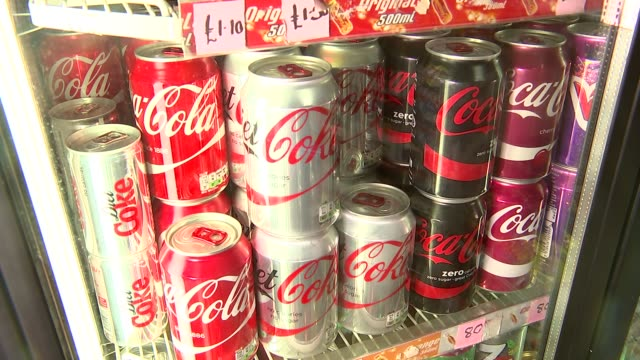 soft drinks ENGLAND INT Various of bottles and cans of soft drinks dipslayed in shops including brands Coca Cola Ribena Lucozade Fanta 7 Up Pepsi