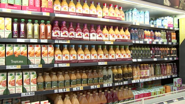vídeos de stock, filmes e b-roll de soft drinks general views england london int gvs soft drinks in supermarket / shelves of orange juice and other fruit juices / tropicana orange juice... - bebida não alcoólica