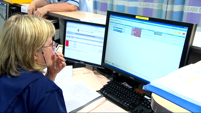 vidéos et rushes de sugary food and drink / birmingham hospital interiors and exteriors birmingham medical staff along in hospital with nurse on phone at desk / medical... - s'appuyant