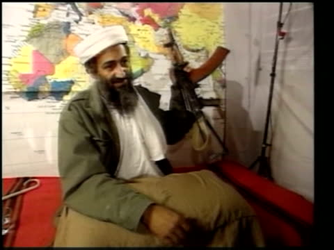 vídeos de stock, filmes e b-roll de suicide bomb attacks briton amongst the dead lib cms osama bin laden holding rifle cs rifle tilt up bin laden - bomb