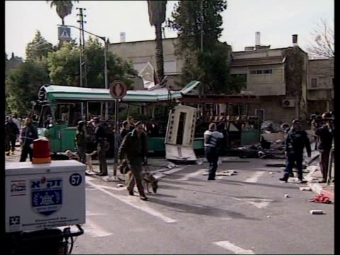 Suicide bomb kills 10 people ITN Jerusalem MS Wreckage of bus which was destroyed in suicide bomb blast PULL OUT security forces on road MS Corpse...