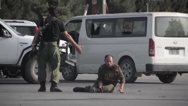 suicide bomber killed several people at the entrance to kabul international airport as scores gathered to welcome home afghan vice president abdul... - suicide bombing stock videos & royalty-free footage