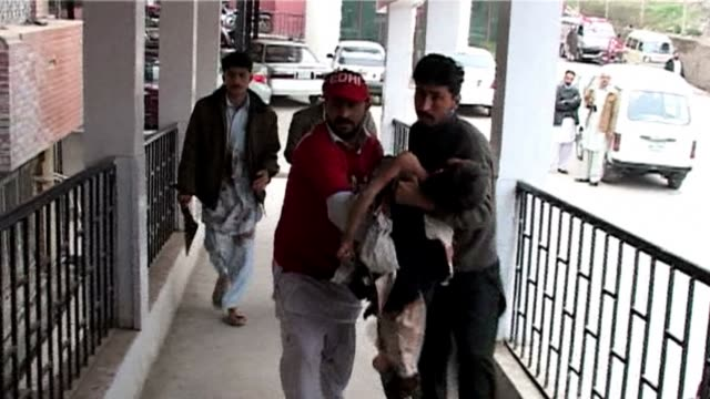 suicide bomber targeted a shiite muslim mosque in northwest pakistan on friday killing 21 people and wounding up to 50 as worshippers poured out of... - peshawar stock videos & royalty-free footage