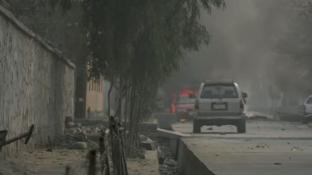 a suicide car bomber targeted an office of the british charity save the children in eastern nangarhar province's jalalabad city on wednesday leaving... - save the children stock videos & royalty-free footage