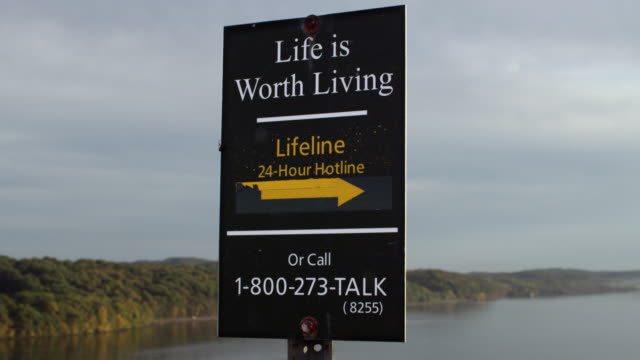 CU of suicide prevention sign on bridge