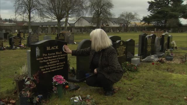 suicide rate among veterans continues to rise; scotland: perth and kinross: ext various of june black at grave of son with interview overlaid sot. - suicide stock videos & royalty-free footage