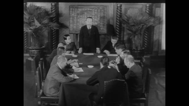 suited japanese men attend meeting in the us during wwii - guerra del pacifico video stock e b–roll