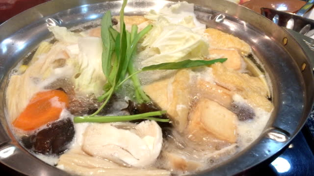 sukiyaki in pot more vegetable - sukiyaki stock videos and b-roll footage