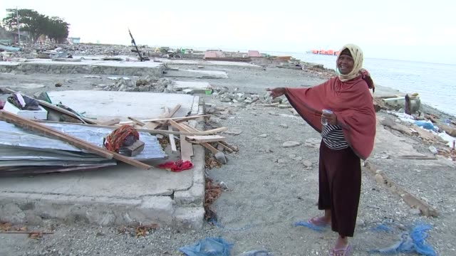 UN says 200000 survivors in disaster zone need aid INDONESIA Sulawesi Loli Saluran People amongst tsunami and earthquake damage INDONESIA Sulawesi...