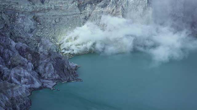 sulfur haze at volcanic lake, kawah ijen volcano, indonesia - sulphur stock videos & royalty-free footage