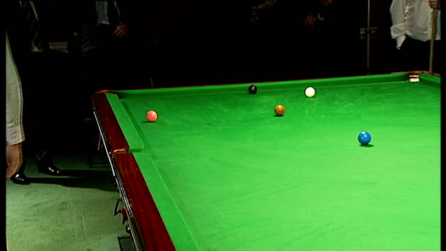 sullivan potting balls on table with interview and music overlaid sot - potting stock videos and b-roll footage