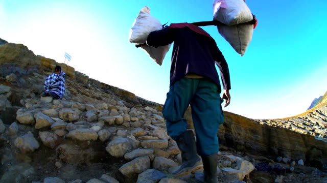 sulphur mining blocks carried by manual indonesian worker - indonesia volcano stock videos & royalty-free footage