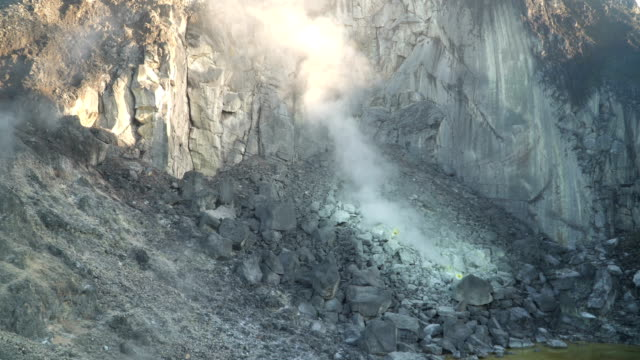 sulphur volcano mouth in crater on sibayak mountain under sunrise - saturated colour stock videos & royalty-free footage