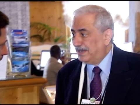 sultan almansouri and saudi finance minister dr ibrahim bin abdulaziz bin abdullah alassaf greeting in hotel lobby / cu of dr ibrahim bin abdulaziz... - sultan stock videos and b-roll footage