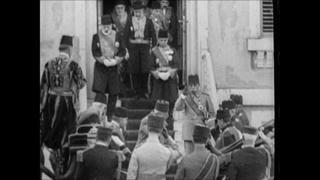 sultan mehmed vi wahid eddin descending down steps from building surrounded by other government officials generals mehmed bowing ws mehmed in... - sultan stock videos and b-roll footage