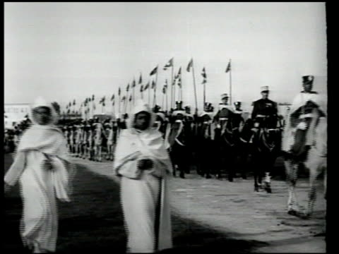 sultan's guard on horseback walking ahead of french horseman officers mounted trumpeters coming through gate walking past ws sultan sidi muhammad v... - 1951 stock videos and b-roll footage