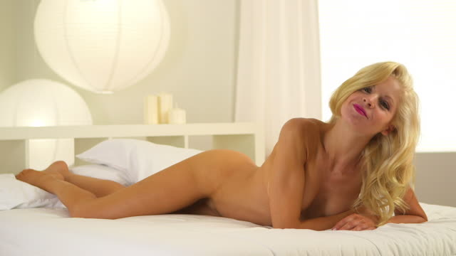 sultry blonde woman lying in bed - blond hair stock videos & royalty-free footage