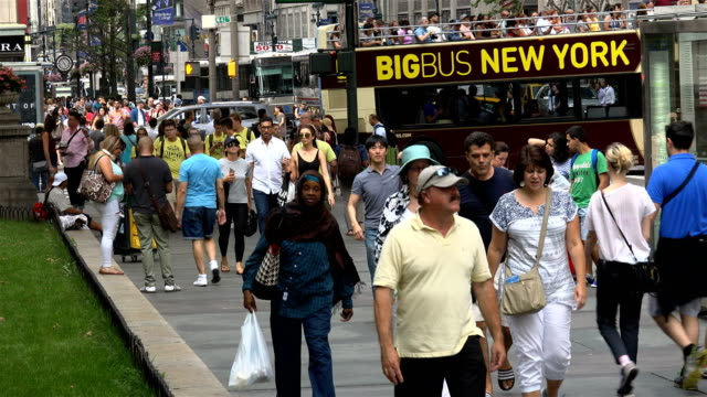 summer afternoon rush hour via 42nd street and 5th avenue, midtown manhattan, new york city, usa / a popular tourist transport big bus tours new york... - 42nd street stock videos & royalty-free footage
