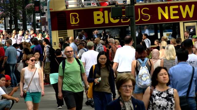 Summer afternoon rush hour via 42nd Street and 5th Avenue Midtown Manhattan New York City USA / A popular tourist transport Big Bus Tours New York...