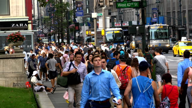 summer afternoon rush hour via 42nd street and 5th avenue midtown manhattan new york city usa - 42nd street stock videos & royalty-free footage