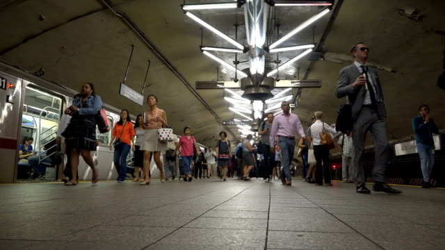 summer afternoon rush hour via the grand central station subway number 7 train platform / services operate between main street in flushing queens and... - 34th street stock videos and b-roll footage
