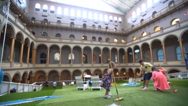 a summer art installation in the us capital invites visitors to lounge on interactive hammocks featuring hidden speakers and play croquet amid... - korinthisch stock-videos und b-roll-filmmaterial