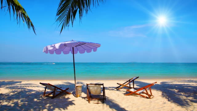 summer beach - beach umbrella stock videos and b-roll footage