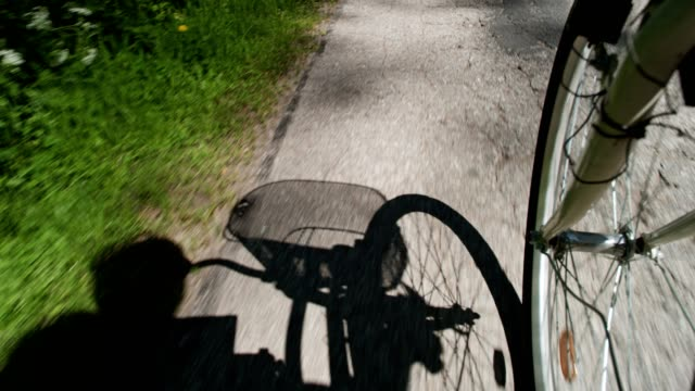 summer bike ride. shadow silhouette - carefree stock videos & royalty-free footage