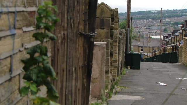 reaction in bradford to welfare changes england west yorkshire bradford ext **george osborne budget speech partly overlaid sot** rubbish bins lining... - ウェストヨークシャー点の映像素材/bロール