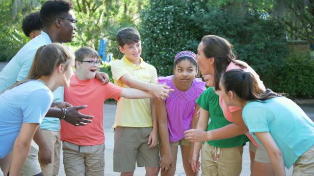 vídeos de stock e filmes b-roll de summer camp including two down syndrome children - 30 39 years