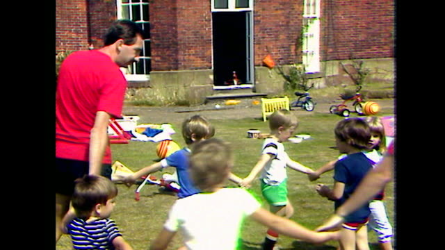 summer camp teachers play with pre-school children; 1984 - child care stock videos & royalty-free footage