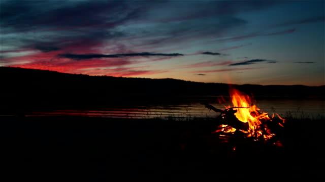 Summer Campfire and Lake at sunset