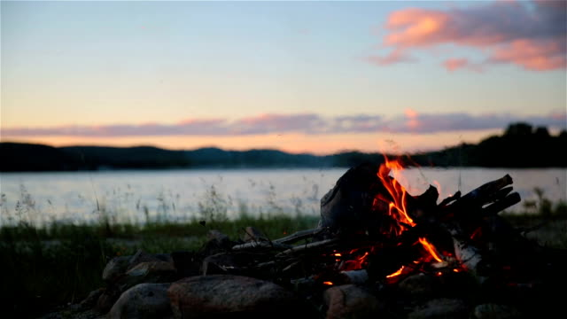 summer campfire and lake at sunset - camping stock videos & royalty-free footage