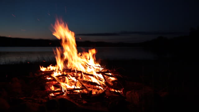 summer campfire and lake at sunset - camp fire stock videos & royalty-free footage