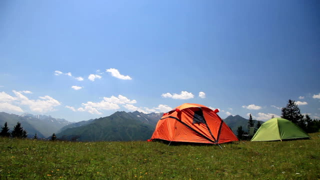 hd: summer camping in idyllic mountain landscape - tent stock videos & royalty-free footage