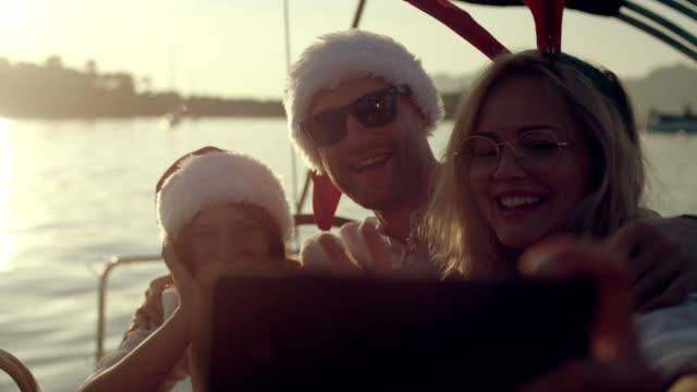 summer christmas greetings - santa hat stock videos & royalty-free footage