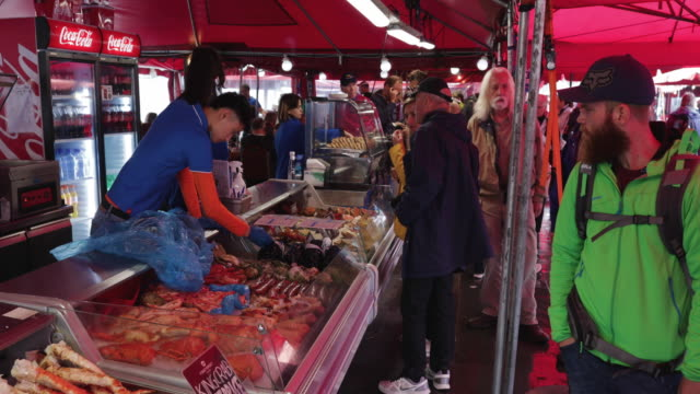 summer day city life in bergen, norway: tourists in the fish market - seafood stock videos & royalty-free footage