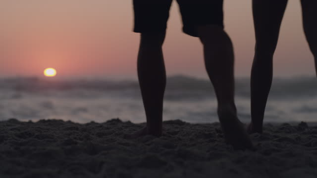 summer days were made for barefoot strolls along the beach - young couple stock videos & royalty-free footage