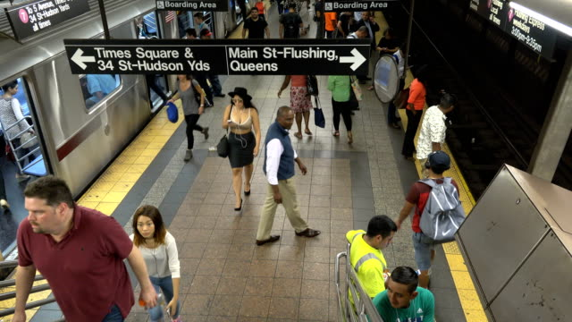 summer evening rush hour at the 42nd street grand central station number 7 subway platform / services operate between main street in flushing queens... - 34th street stock videos and b-roll footage