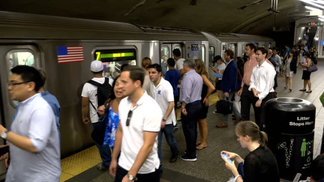 summer evening rush hour at the 42nd street grand central station number 7 subway platform / services operate between main street in flushing, queens... - 34th street stock videos & royalty-free footage