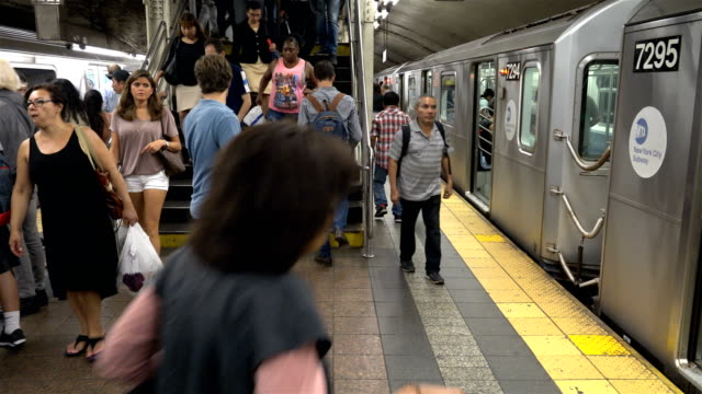 Summer evening rush hour at the 42nd Street Grand Central Station number 7 subway platform / Services operate between Main Street in Flushing Queens...