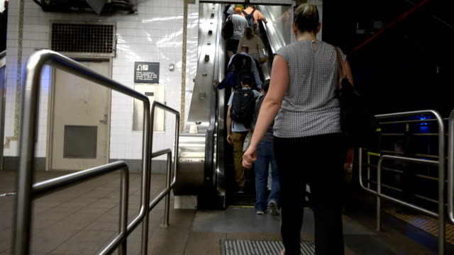 summer evening rush hour at the 42nd street grand central station number 7 subway platform / services operate between main street in flushing, queens... - number 7 stock videos & royalty-free footage